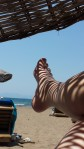 Admiring the sunshine and shadows on my legs on a beach in Turkey this year